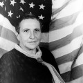 Portrait of Gertrude Stein, with American flag as backdrop 1935