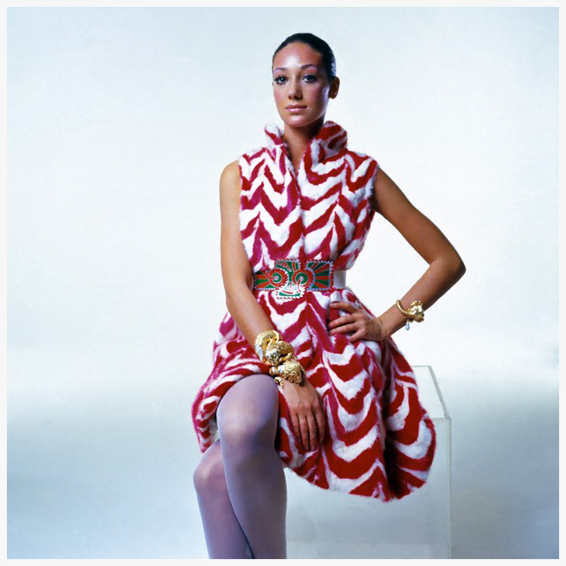 marisa-berenson-wearing-a-sleeveless-coatdress-of-scarlet-and-white-dyed-mink-in-a-chevron-stripe-design-by-george-kaplan-tiffany-and-co-safari-theme-bracelets-of-gold-and-precious-sto
