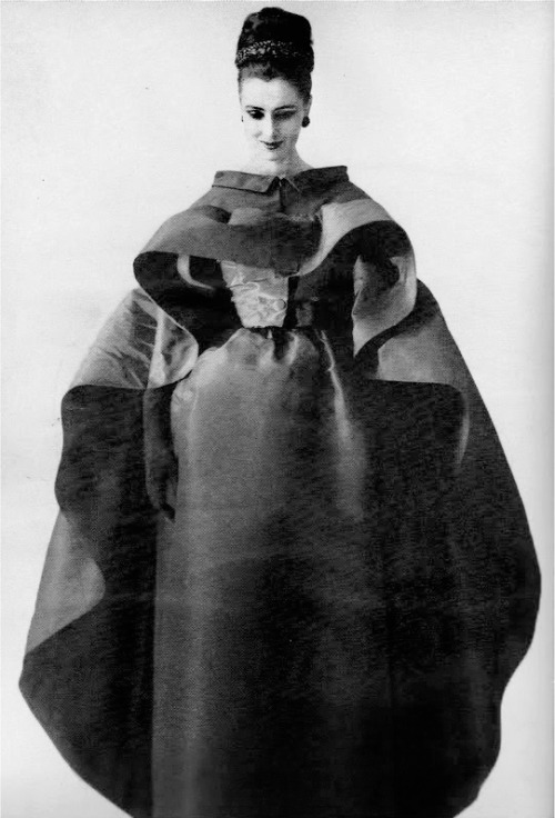 1961 Maggi Eckardt wearing a Cristóbal Balenciaga dress and cape, photographed by Tom Kublin for Harper's Bazaar, November 1961