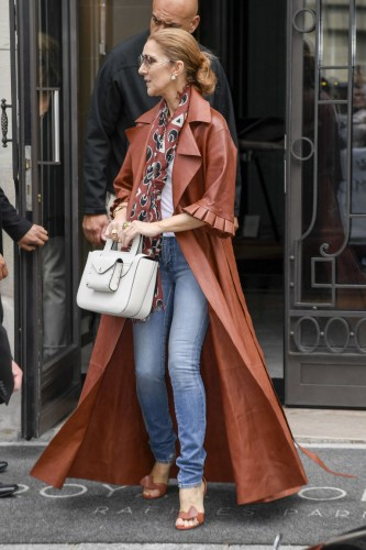 gallery-1466538455-celine-dion-off-white-coat-spl1304985-008