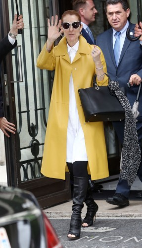 gallery-1466539156-celine-dion-yellow-coat-spl1306072-003