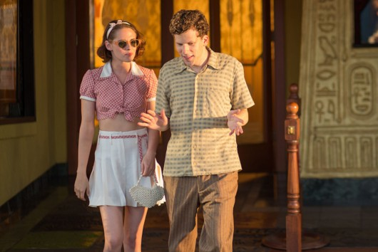 "A still from ""Cafe Society"" showing Kristen Stewart in custom-made white silk Chanel shorts alongside Jesse Eisenberg"