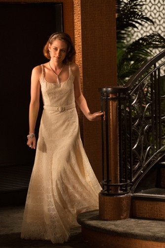 "A still from ""Cafe Society"" showing Kristen Stewart in a custom-made off-white silk and lace Chanel dress and Chanel fine jewelry"