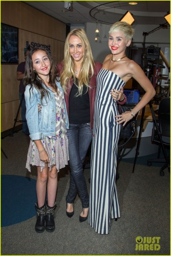 ORANGE, CA - MARCH 22: (L-R) Noah Cyrus , Tish Cyrus, and Miley Cyrus attend the Ryan Seacrest Foundation's West Coast debut of a new multi-media broadcast center, Seacrest Studios, with a live broadcast on KIIS FM at CHOC Children's Hospital on March 22, 2013 in Orange, California. (Photo by Paul A. Hebert/Getty Images)